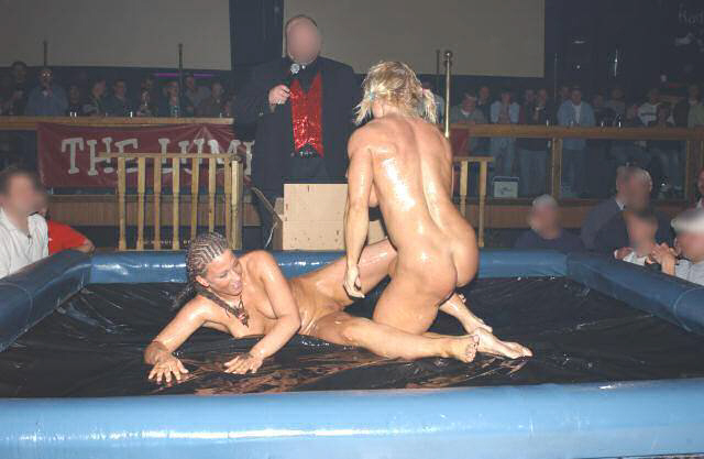 Naked women oil wrestling